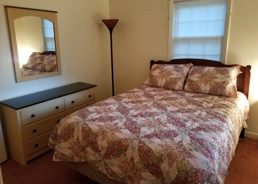 roomy bedroom in Little Fawn rental cabin