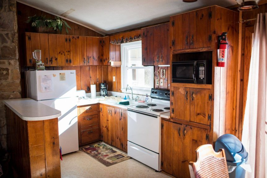 rustic cabinets in kitchen of Vista Grande rental cabin
